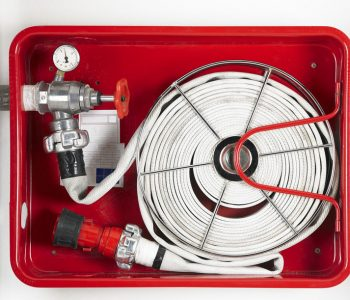 Fire hose equipment in a red metallic box. Horizontal